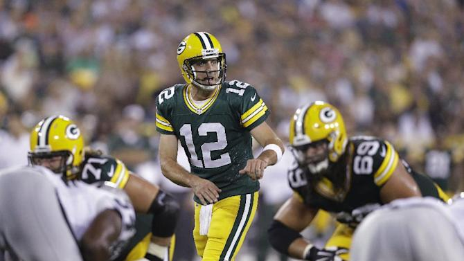 In this Aug. 22, 2014, photo, Green Bay Packers quarterback Aaron Rodgers approaches the line of scrimmage during the first half of an NFL preseason football game against the Oakland Raiders in Green Bay, Wis. Rodgers' first start at Seattle is making a lot of fantasy football owners squeamish