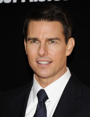 """FILE - In this Dec.19, 2011 file photo, actor Tom Cruise attends the U.S. premiere of """"Mission: Impossible - Ghost Protocol"""" in New York. Cruise was almost as excited to be at Comic-Con as fans were to see him. The megastar came to the pop-culture festival Saturday July 20, 2013, in San Diego for the first time to showcase his latest film, """"Edge of Tomorrow.""""(AP Photo/Evan Agostini, file)"""