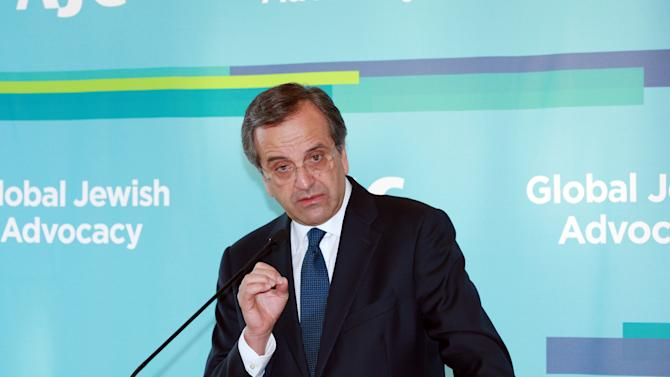 Antonis Samaras, Greek Prime Minister, addresses a breakfast meeting with leadership of the American Jewish Committee in New York, Monday, Sept. 30, 2013. (AP Photo/David Karp)