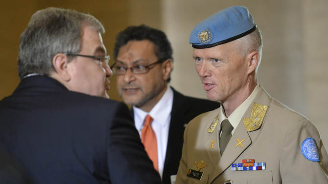 Major-General Robert Mood, from Norway head of the UN Supervision Mission in Syria and Chief Military Observer, right, talks to an unidentified perspon as he arrives for a meeting of the Action Group for Syria at the European headquarters of the United Nations, UN, in Geneva, Switzerland, Saturday, June 30, 2012. (AP Photo/Keystone, Martial Trezzini)