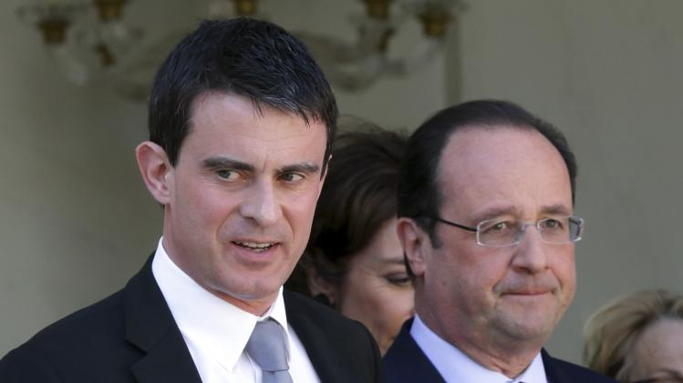 French President Hollande and Prime Minister Valls leave the weekly cabinet meeting at the Elysee Palace in Pari