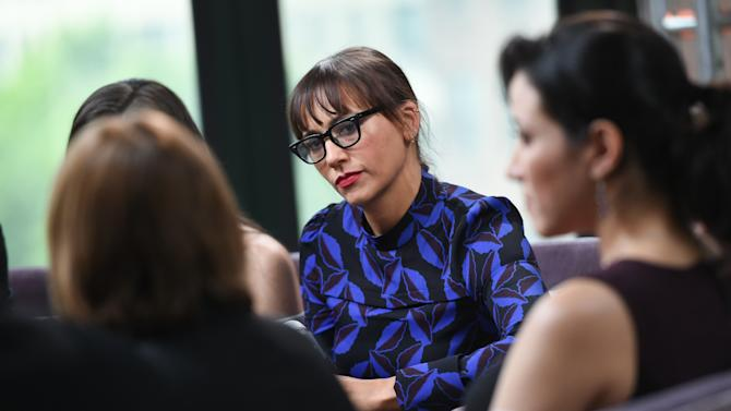 "Producer Rashida Jones, center, participates in AOL's BUILD Speaker Series to discuss the film ""Hot Girls Wanted"" at AOL Studios on Wednesday, May 27, 2015, in New York. (Photo by Evan Agostini/Invision/AP)"