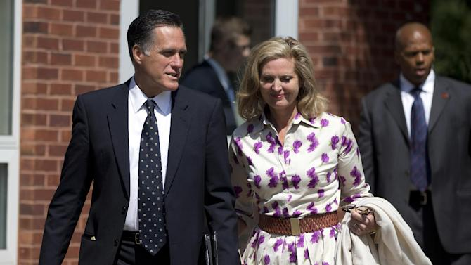 Republican presidential candidate, former Massachusetts Gov. Mitt Romney and his wife Ann, leave the Church of Jesus Christ of Latter-day Saints after services on Sunday, Sept. 2, 2012 in Wofeboro, N.H.  (AP Photo/Evan Vucci)