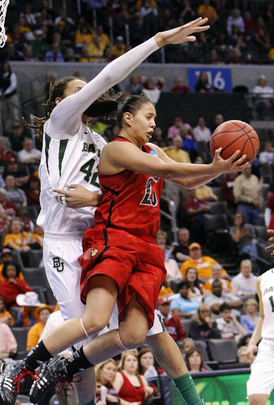Louisville guard Shoni Schimmel (23) takes a reverse shot over Baylor's Brittney Griner (42) during the second half of a regional semifinal in the women's NCAA college basketball tournament in Oklahoma City, Sunday, March 31, 2013.  Louisville won 82-81. (AP Photo/Alonzo Adams)