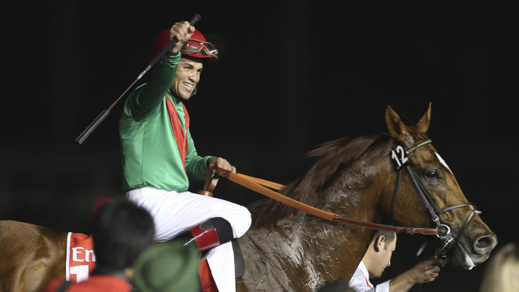 Joel Rosario, jockey of Animal Kingdom of U.S. celebrates after he wins the 6,000,000 (4,679,275 euro) 1st place prize of Dubai World Cup at Meydan racecourse in Dubai, United Arab Emirates, Saturday, March 30, 2013. (AP Photo/Kamran Jebreili)