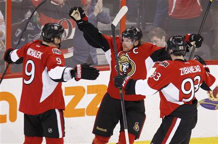 Senators' Alfredsson celebrates his goal on the Penguins with teammates Michalek and Zibanejad during the third period in Game 3 of their NHL Eastern Conference semi-final playoff hockey game in Ottaw