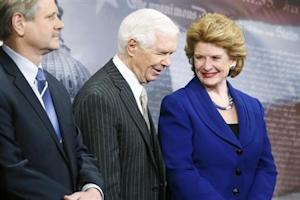 U.S. Senate Agriculture Committee Chairman Stabenow smiles with ranking member Senator Cochrane at a news conference after the final passage of the Farm Bill at the U.S. Capitol in Washington