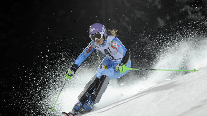 Slovenia's Tina Maze speeds past a pole on her way to clock the eight fastest time in the first run of an alpine ski, women's World Cup slalom, in Flachau, Austria, Tuesday, Jan. 15, 2013. (AP Photo/Giovanni Auletta)