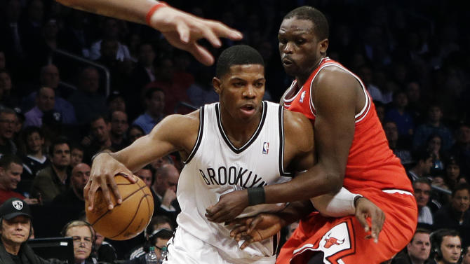 Brooklyn Nets guard Joe Johnson, left, tries to drive past Chicago Bulls forward Luol Deng in the first half of Game 2 of their first-round NBA basketball playoff series, Monday, April 22, 2013, in New York. (AP Photo/Kathy Willens)