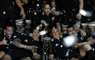 New Zealand's All Blacks players celebrate after defeating Argentina's Los Pumas, 54-15, and winning the Rugby Championship, at La Plata stadium in La Plata, Argentina, on September 29
