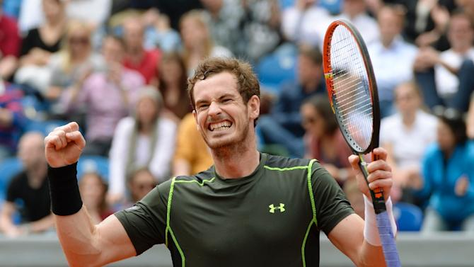 Andy Murray celebrates after beating Philipp Kohlschreiber in the final the Munich ATP tournament on May 4, 2015