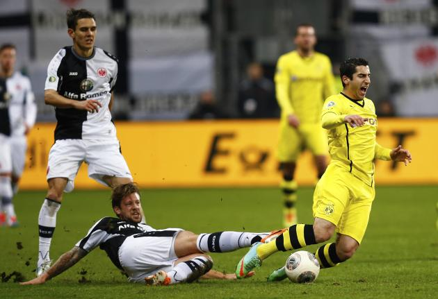 Eintracht Frankfurt's Russ challenges Borussia Dortmund's Mkhitasryan during their German soccer cup (DFB Pokal) quarter-final soccer match in Frankfurt