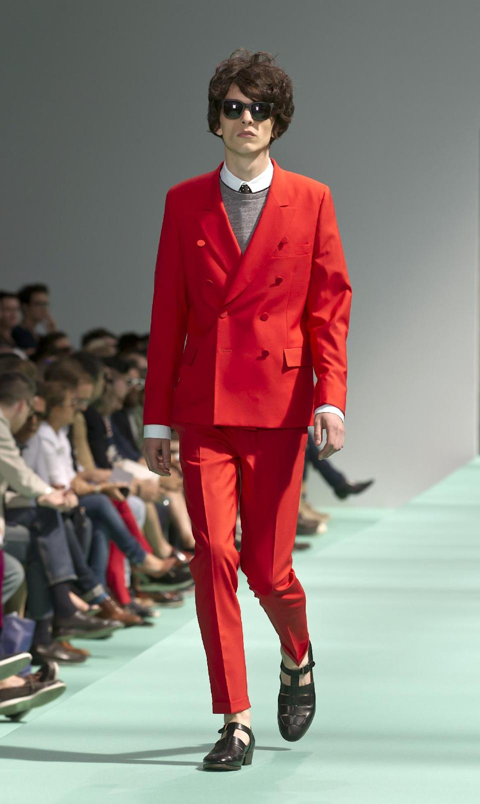 A model wears a creation by British fashion designer Paul Smith during his Men's Spring-Summer 2013 collection, for fashion house in Paris, France, Sunday, July 1, 2012. (AP Photo/Jacques Brinon)