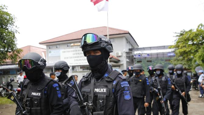 Members of the Indonesian special police leave the ferry port  after returning from the prison island of Nusa Kambangan following a prisoner transfer in Cilacap