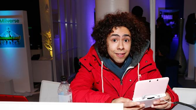 Actor Ramy Youssef warms up and checks out Nintendo 3DS XL at the Nintendo Lounge during a break from the Sundance Film Festival on Saturday, January 19, 2013 in Park City, UT. (Photo by Todd Williamson/Invision for Nintendo/AP Images)