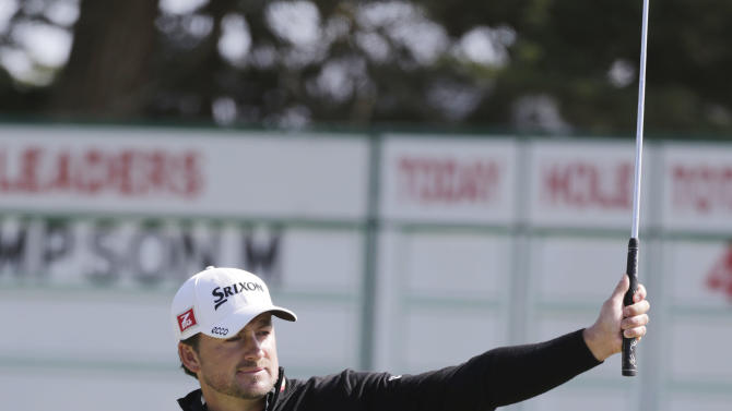 Graeme McDowell, of Northern Ireland, reacts after making a birdie putt on the 15th hole during the second round of the U.S. Open Championship golf tournament Friday, June 15, 2012, at The Olympic Club in San Francisco. (AP Photo/Eric Gay)