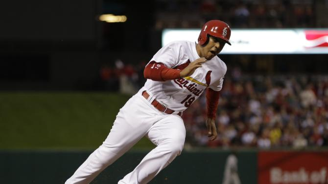 St. Louis Cardinals' Jon Jay rounds third and heads home to score on a single by Pete Kozma during the second inning of a baseball game against the Colorado Rockies, Friday, May 10, 2013, in St. Louis. (AP Photo/Jeff Roberson)