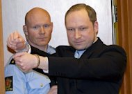Norwegian right-wing extremist Anders Behring Breivik (R) arrives in court in Oslo in February 2012. Breivik came across as your average guy but behind his courteous exterior lurked one of history's most gruesome killers fuelled by a hatred of multiculturalism and Islam