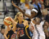 Indiana Fever's Katie Douglas is guarded by Connecticut Sun's Tina Charles in the second half of a WNBA basketball game in Uncasville, Conn., Wednesday, Sept. 19, 2012. Connecticut won 73-67. (AP Photo/Jessica Hill)