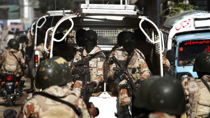Pakistan paramilitary troops patrol in Karachi, Pakistan, Monday, Dec. 10, 2012. Gunmen attacked a checkpoint manned by paramilitary forces on the outskirts of the southern city of Karachi, killing soldiers, police said. (AP Photo/Shakil Adil)