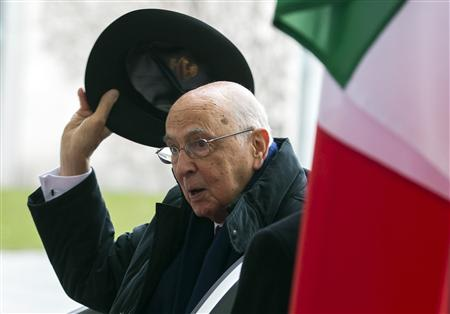 Italian President Giorgio Napolitano lifts his hat as he meets with German Chancellor Angela Merkel (not pictured) for talks at the Chancellery in Berlin in this February 28, 2013 file photo. REUTERS/Thomas Peter/Files