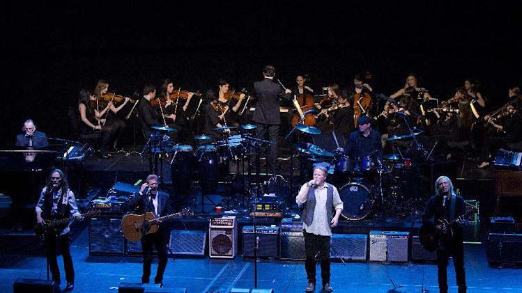 This image released by New York University shows the NYU Steinhardt orchestral string ensemble performing with members of the Eagles, foreground from left, Timothy B. Schmit, Glenn Frey, Don Henley and Joe Walsh at the Inaugural Vision Award Gala, Thursday, Nov. 15, 2012 in New York.  (AP Photo/New York University, Mathieu Asselin)