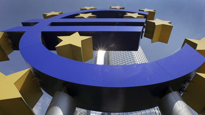 FILE - In this Aug. 6, 2009 file photo, the sun is reflected on the facade of the European Central Bank ECB Tower, seen through the Euro symbol,  in Frankfurt, central Germany. Ninety European banks get their test results back Friday, July 15, 2011 as regulators seek to increase transparency and convince the markets that the global financial system can withstand big shocks like a possible Greek debt default. (AP Photo/Daniel Roland, File)