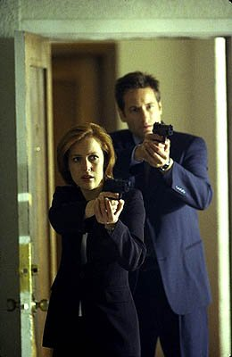 "Scully (Gillian Anderson, L) and Mulder (David Duchovny, R) investigate a number of murders that lead to the discovery of a ""monster"" who kills to feed a gruesome habit in the ""Hungry"" episode of Fox'"
