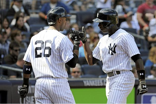 New York Yankees' Alfonso Soriano, right, celebrates with Eduardo Nunez after Soriano hit a home run during the sixth inning of an inter-league baseball game Saturday, Sept. 21, 2013, at Yankee Stadiu