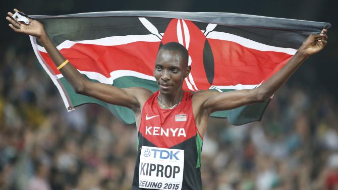 Kiprop of Kenya reacts after winning the men's 1500m event during the 15th IAAF World Championships at the National Stadium in Beijing