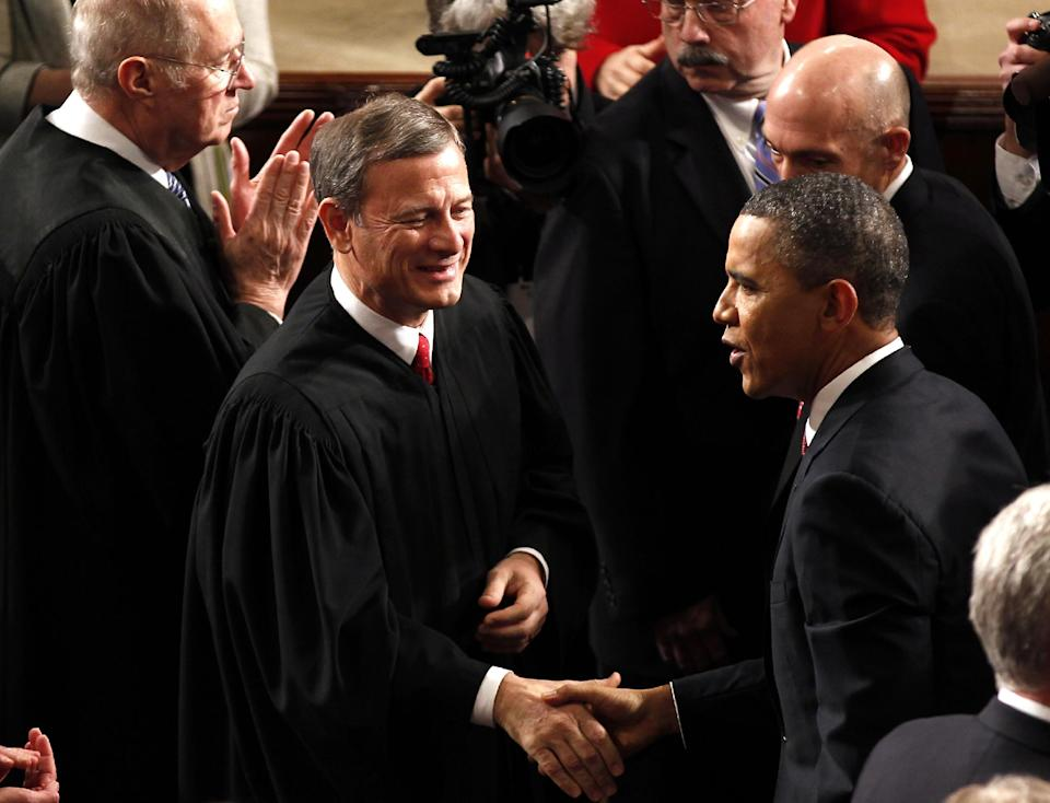 Supreme Court Chief Justice John Roberts greets President Barack Obama on Capitol Hill in Washington, Tuesday, Jan. 24, 2012, prior to the president's State of the Union address. (AP Photo/J. Scott Applewhite)