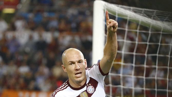 Bayern Munich's Robben celebrates after scoring against AS Roma during their Champions League soccer match at the Olympic stadium in Rome
