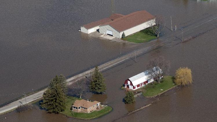 Buildings in James Township on South Center near the Tittabawassee River are flooded on Monday, April 22, 2013. Area rivers overflowed their banks over the weekend after days of heavy rain saturated the ground. (AP Photo/Jeff Schrier, The Saginaw News)