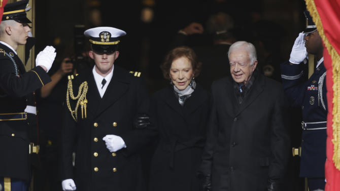 Former President Jimmy Carter arrives with his wife Rosalynn at the ceremonial swearing-in for President Barack Obama at the U.S. Capitol during the 57th Presidential Inauguration in Washington, Monday, Jan. 21, 2013. (AP Photo/Pablo Martinez Monsivais)