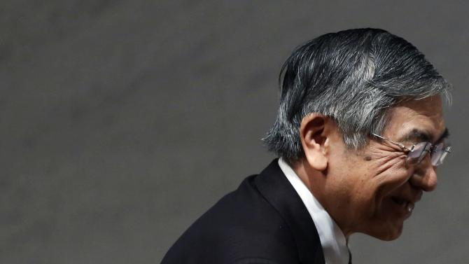 Bank of Japan Governor Kuroda leaves after his speech at a year end meeting at Japan Business Federation in Tokyo