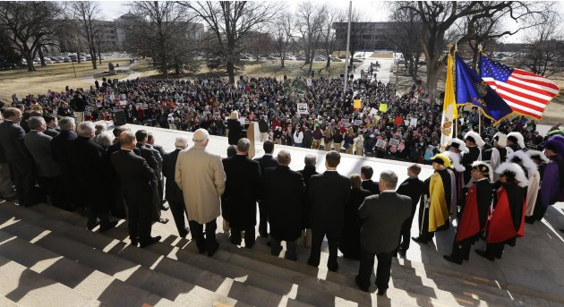 Abortion opponents gather for a rally at the Kansas Statehouse, on the 40th anniversary of Roe v. Wade, in Topeka, Kan., Tuesday, Jan. 22, 2013. Gov. Sam Brownback has signed a series of tough, anti-a