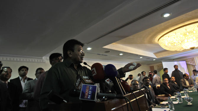 Former Pakistani President Pervez Musharraf talks to his party members during a ceremony to celebrate Pakistan National Day ahead his trip to Karachi on Sunday, in Dubai, United Arab Emirates, Saturday, March 23, 2013. Musharraf says he will follow through with his plans to return to his homeland despite risks of arrest and other threats. (AP Photo/Kamran Jebreili)