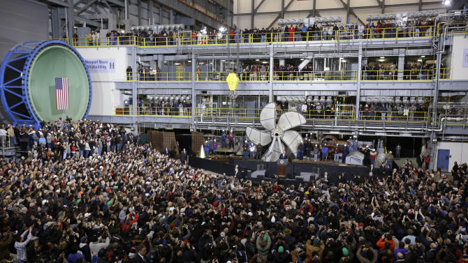 President Barack Obama, at podium, gestures during a speech about about automatic defense budget cuts, Tuesday, Feb. 26, 2013, at Newport News Shipbuilding in Newport News, Va.  (AP Photo/Steve Helber)