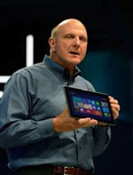 <p>Steve Ballmer, Microsoft CEO, holds the Surface tablet at a news conference in California in June. The new Office comes as Microsoft readies a Surface tablet computer to take on the iPad and seeks to expand in the smartphone market with version of Windows 8 tailored for mobile gadgets.</p>