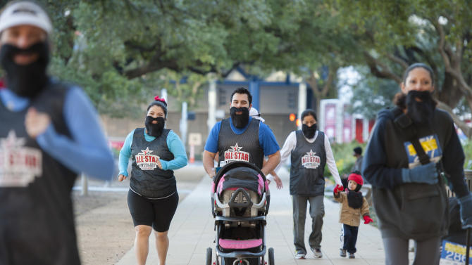 IMAGE DISTRIBUTED FOR RELIANT - Reliant employees wear James Harden beards as they warm up the NBA All-Star Run, Walk and Dribble 5K Run, Saturday, Feb. 16, 2013, in Houston. (Dave Einsel/AP Images for Reliant)