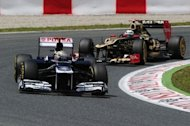 William's Venezuelan driver Pastor Maldonado (L) and Lotus F1's Finnish driver Kimi Raikkonen jockey for position on the Circuit de Catalunya in Montmeló on the outskirts of Barcelona during the Spanish F1 Grand Prix on May 13, 2012. Maldonado handed Williams a welcome Formula One victory by winning Sunday's race