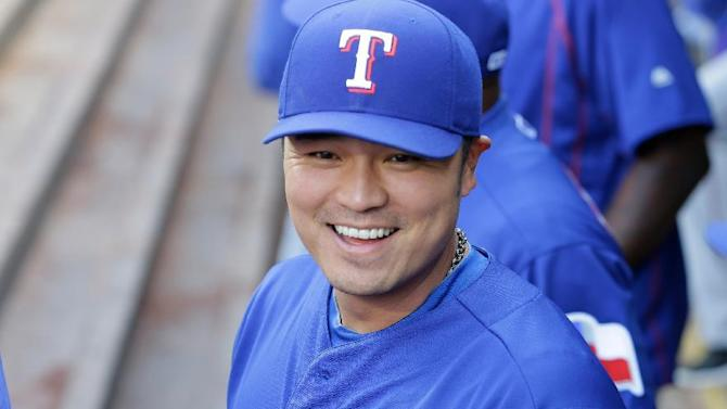 Texas Rangers designated hitter Shin-Soo Choo stands on the dugout before a baseball game against the Seattle Mariners, Saturday, April 18, 2015, in Seattle. (AP Photo/Ted S. Warren)