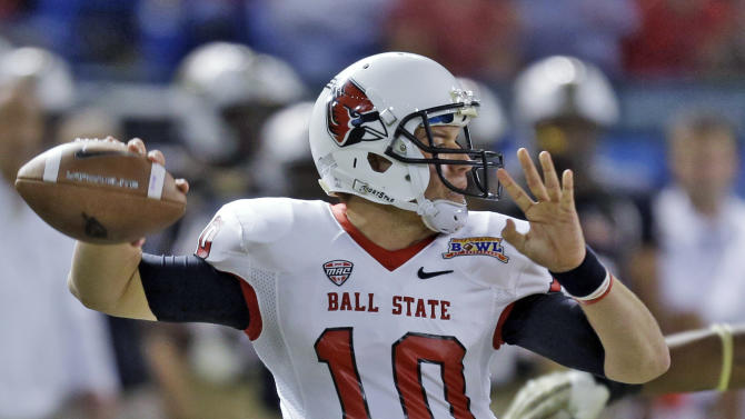 Ball State quarterback Keith Wenning throws a pass against Central Florida during the first quarter of the Beef 'O' Brady's Bowl NCAA college football game Friday, Dec. 21, 2012, in St Petersburg, Fla. (AP Photo/Chris O'Meara)