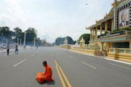 A Cambodian Buddhist monk prays for the late former king Norodom Sihanouk in front of the Royal Palace in Phnom Penh on October 18, 2012. Cambodia has begun preparations to embalm its revered former king, who will lie in state at the palace for three months ahead of a lavish funeral, a royal aide said