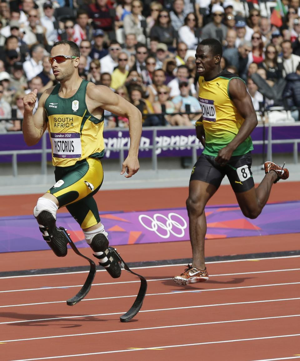 South Africa's Oscar Pistorius, left, and Jamaica's Rusheen McDonald compete in a men's 400-meter heat during the athletics in the Olympic Stadium at the 2012 Summer Olympics, London, Saturday, Aug. 4, 2012. (AP Photo/David J. Phillip )