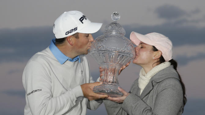 Michael Thompson, left, and his wife Rachel kiss Thompson's trophy after he won the final round of the Honda Classic golf tournament, Sunday, March 3, 2013 in Palm Beach Gardens, Fla. (AP Photo/Wilfredo Lee)