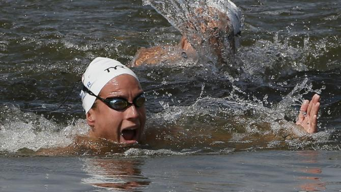 Miller of France reacts as she wins in front of Dutch swimmer van Rouwendaal in the women's 10km open water race at the Aquatics World Championships in Kazan