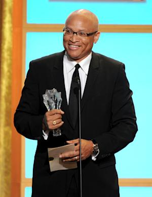 "In this Monday, June 10, 2013, photo, Larry Wilmore accepts the best talk show award for ""The Daily Show with Jon Stewart"" at the Critics' Choice Television Awards in the Beverly Hilton Hotel in Beverly Hills, Calif. Writer-comic Larry Wilmore of ""The Daily Show"" has earned Stephen Colbert's coveted Comedy Central timeslot following Jon Stewart each night. (Photo by Frank Micelotta/Invision/AP)"