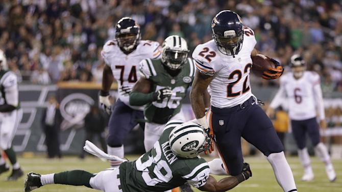 Chicago Bears running back Matt Forte (22) is tackled by New York Jets free safety Antonio Allen (39) in the third quarter of an NFL football game, Monday, Sept. 22, 2014, in East Rutherford, N.J