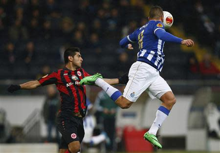 Eintracht Frankfurt's Zambrano challenges Porto's Ghilas during their Europa League soccer match in Frankfurt